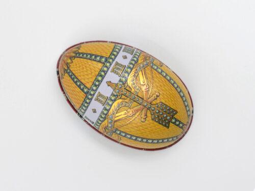 Påskägg i plåt: Fabergé Regal Guldgul