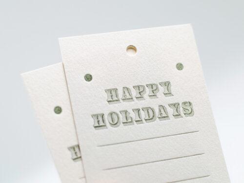 Julklappsetikett HAPPY HOLIDAYS, blekt vitt papper